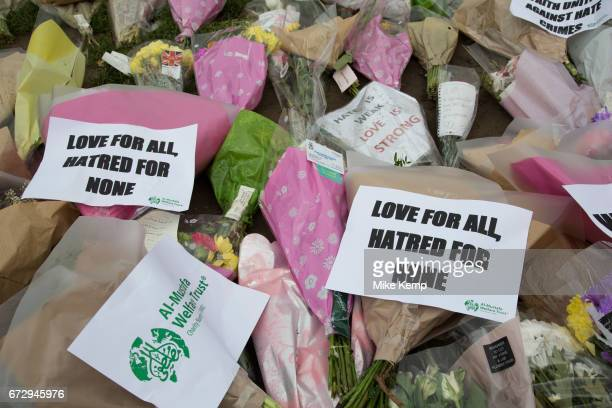 Memorial flowers and notices to PC Keith Palmer who was killed during the Westminster terror attack in London England United Kingdom