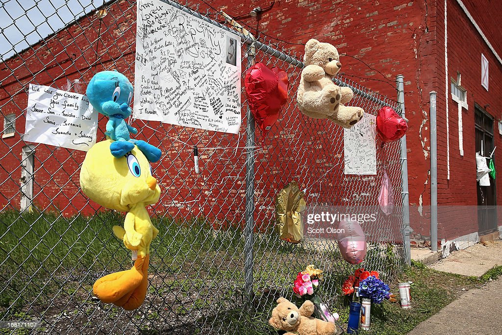 A memorial for 47-year-old Denise Warfield is attached to a fence next to an abandoned church building on May 6, 2013 in Chicago, Illinois. Warfield was found stabbed to death inside the church on Saturday May 4. Less than two blocks from Warfield's murder, three men were shot while walking near the First Mennonite Church of Chicago shortly after midnight Monday morning.