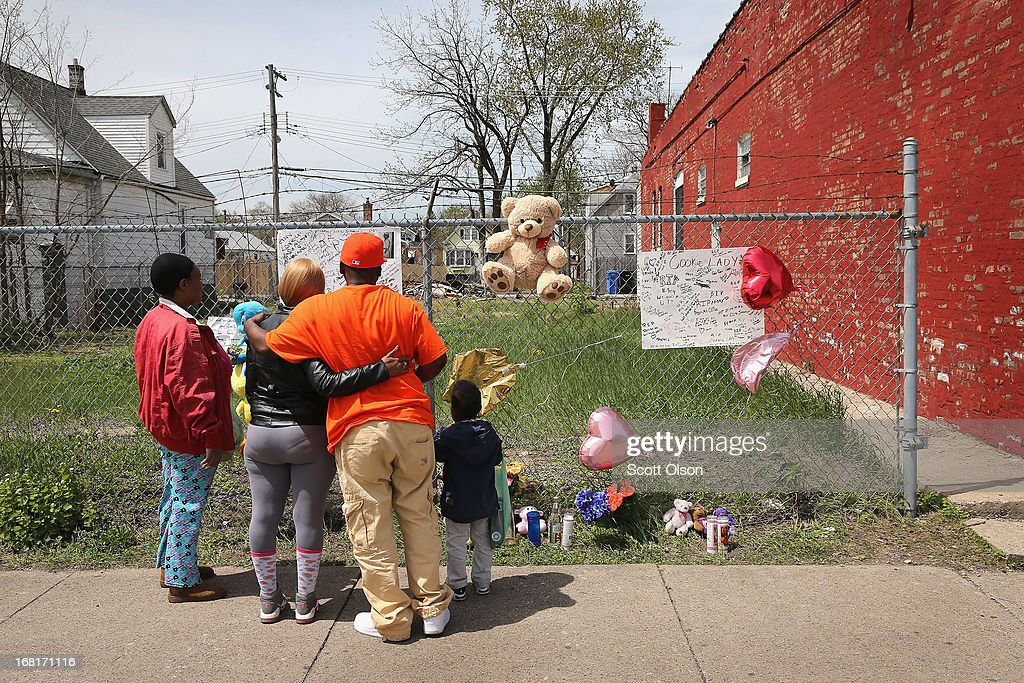 A memorial for 47-year-old Denise Warfield is attached to a fence next to an abandoned church building (R) on May 6, 2013 in Chicago, Illinois. Warfield was found stabbed to death inside the church on Saturday May 4. Less than two blocks from Warfield's murder, three men were shot while walking near the First Mennonite Church of Chicago shortly after midnight Monday morning.