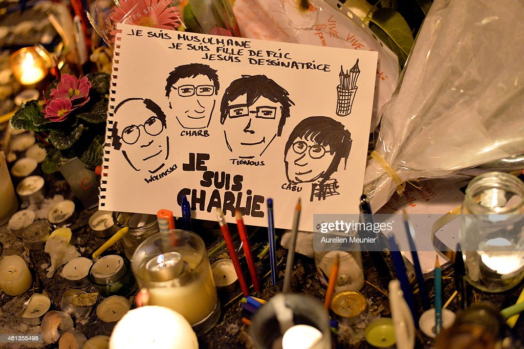 A memorial is seen near the Charlie Hebdo offices during the mass unity rally on January 11 2015 in Paris France An estimated one million people have...