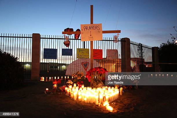 A memorial is seen near the Inland Regional Center as the community remembers those injured and killed during the shooting at the center on December...