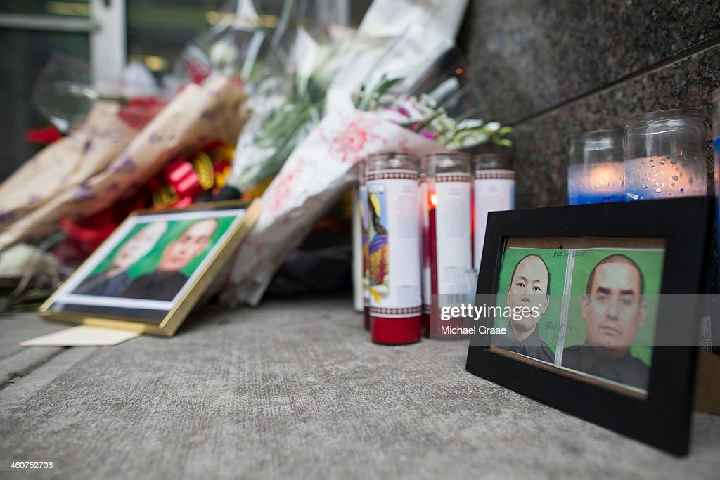 A memorial of candles and flowers in front of the New York Police Department's 84th Precinct on December 21 2014 in the Brooklyn borough of New York...