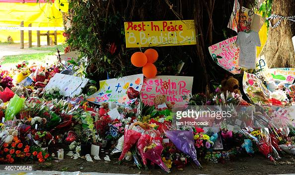 A memorial of flowers toys and candles is seen in a park next to the home of a multiple stabbing in the suburb of Manoora on December 20 2014 in...