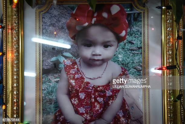 A memorial photograph of slain 11month old girl Natalie is displayed at a temple in Phuket on April 27 2017 Thai media came under fire on April 26...