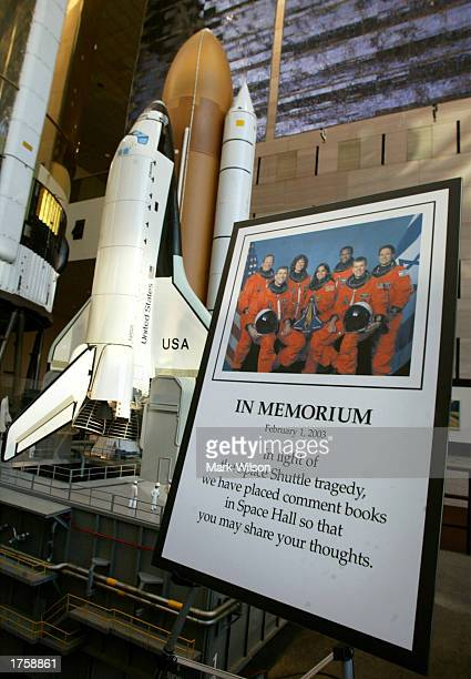 A memorial photograph stands in front of a model of the Space Shuttle Columbia at the National Air and Space Museum February 3 2003 in Washington DC...