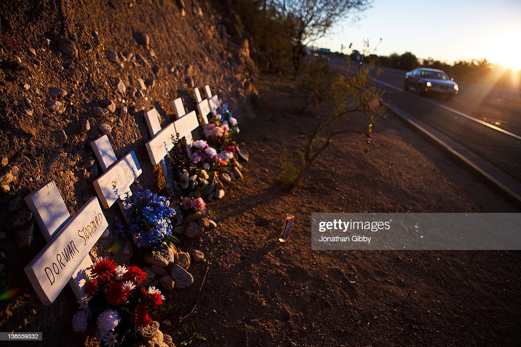 A memorial rests on the highway for the six people that lost their lives in a deadly shooting last year across from the La Toscana Village Safeway January 8, 2012 in Tucson, Arizona. Memorial services will be held throughout the day in Tucson to commemorate the one year anniversary of a shooting rampage that killed six people and wounded more than a dozen more including U.S. Rep. Gabrielle Giffords (D-AZ).
