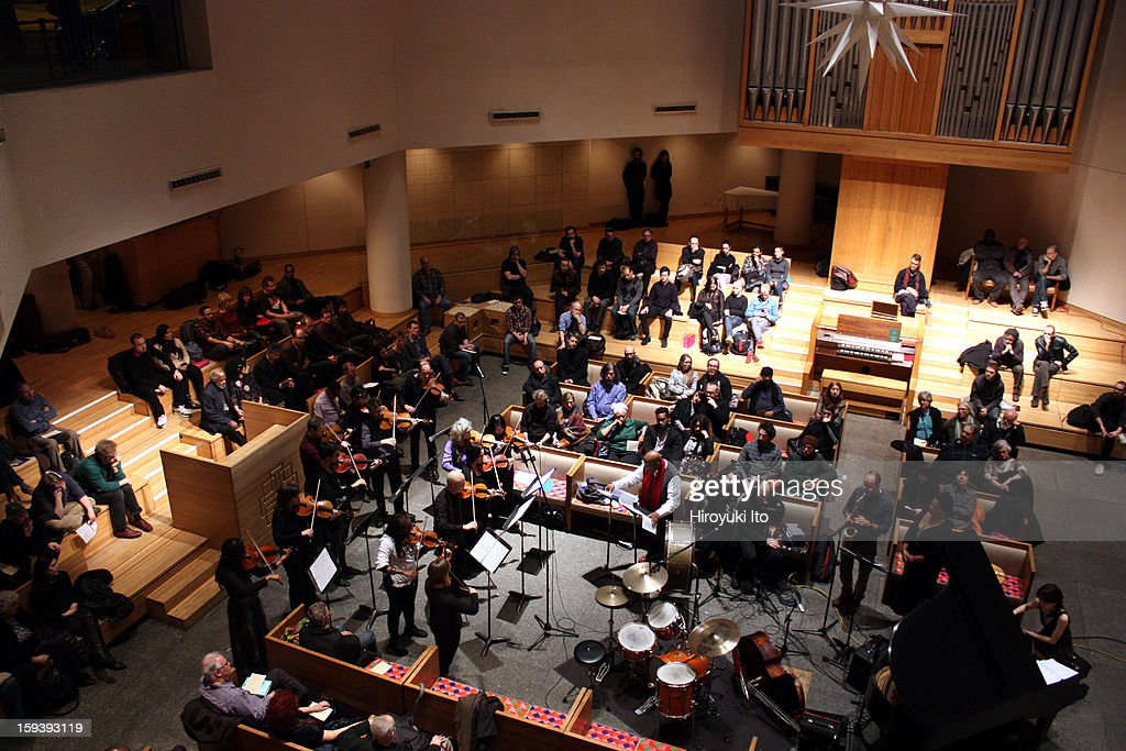 A memorial service for the tenor saxophonist David S. Ware at St. Peter's Church on Monday night, January 7, 2013.This image:William Parker, in center with red scarf, conducting 'Prayer.'