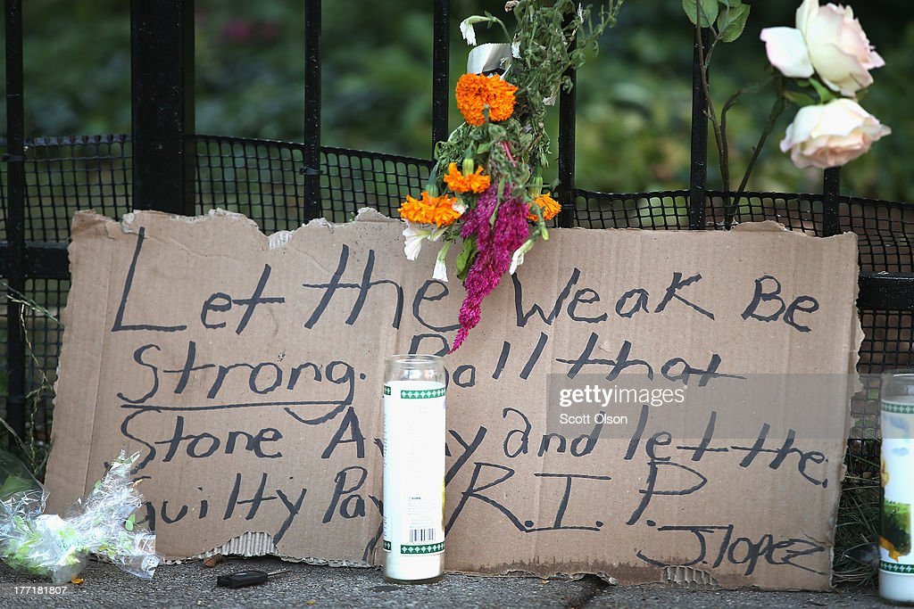 A memorial sits on the edge of the sidewalk outside the Uptown Baptist Church near where the victims of Monday's shooting fell on August 21, 2013 in Chicago, Illinois. Five people were shot while standing in front of the church on August 19 when a gunman opened fire from a passing car.