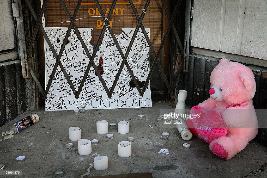 A memorial sits outside a shuttered bakery near the location where a 20-year-old man died from a gunshot wound to the head and a 15-year-old boy was shot and wounded during weekend violence on May 13, 2013 in Chicago, Illinois. Three people were shot and killed and at least six others were wounded in gun violence in the city this past weekend. Chicago Police Superintendent Garry McCarthy held a press conference today to announce his department had seized more than 2,500 illegal firearms in the city so far this year.