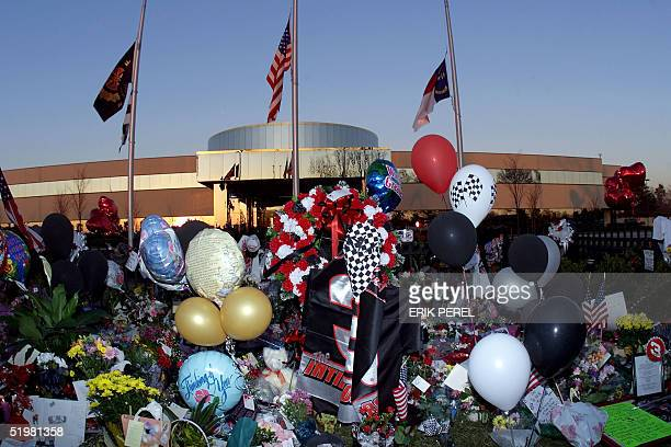 A memorial stands outside the gates of NASCAR driver Dale Earnhardt's corporate headquarters with flags at half staff 19 February 2001 in Moorseville...