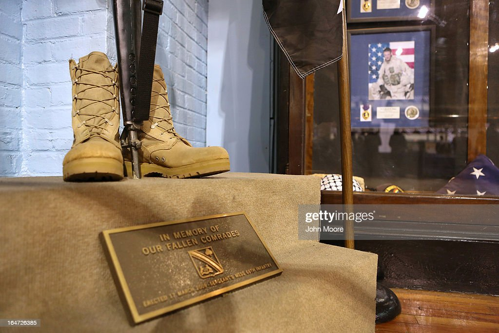 A memorial to slain U.S. military personel stands at the Hiring Our Heroes job fair held at the 69th Regiment Lexington Avenue Armory on March 27, 2013 in New York City. Hundreds of veterans and their spouses turned out to meet more than 100 employers participating at the second annual event, hosted by the U.S. Chamber of Commerce National Chamber Foundation. Lead sponsors were Capital One Financial Corporation and Toyota.
