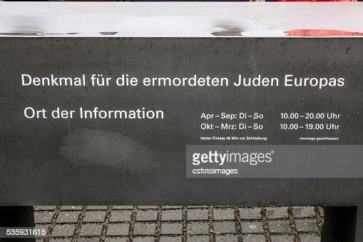 Memorial to the Murdeed Jews of Europe sign in Berlin : Stock Photo