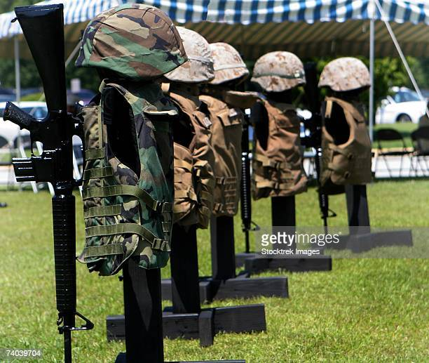 Memorials of flak jackets and helmets form a temporary monument in front of the Naval Hospital June 16. The nine memorials represent Naval Hospitalmen, or corpsmen, killed in action since June 2005.