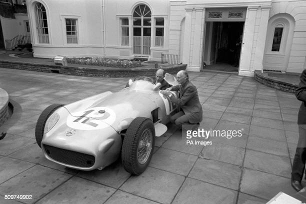 ** Memories of 1955 are recalled by Stirling Moss seated in the actual Mercedes racing car in which he won his first Grand Prix as he handed it over...