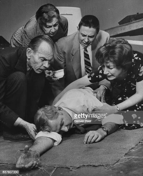 Memories of the past combined with alcohol overpower the doctor and he passes out in anguished grasp of his wife Others in the scene are two members...