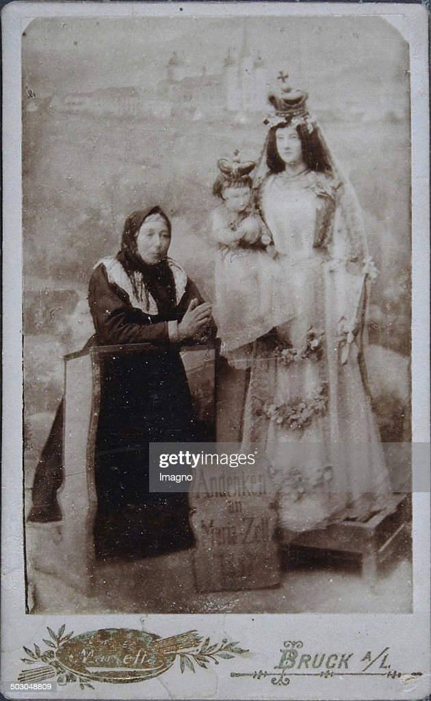 Memory of Maria-Zell. Peasant woman with headscarf and apron - kneeling on a kneeler - in front of her a life-size Madonna with Child Jesus. Full figure. About 1885. Carte de visite photograph by studio-Marietta (formerly Steidl) Bruck an der Leitha.