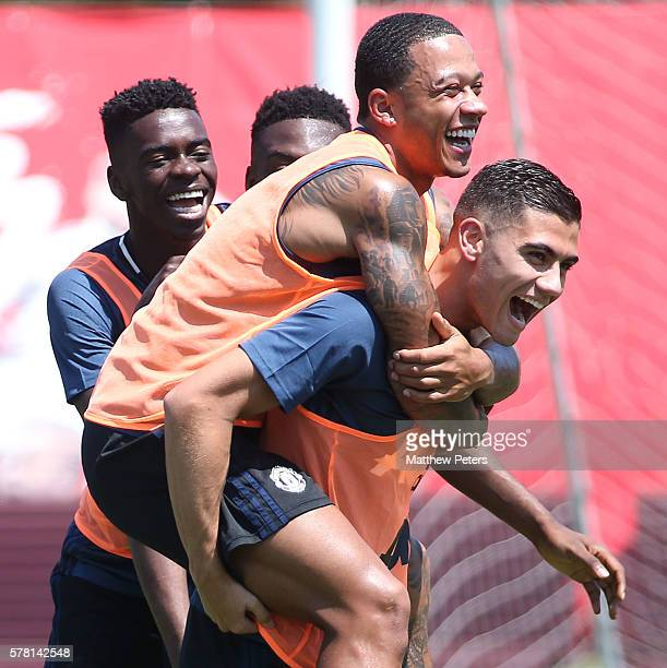 Memphis Depay and Andreas Pereira of Manchester United in action during a first team training session as part of their preseason tour of China at...