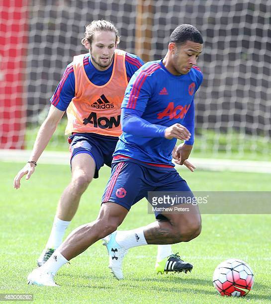 Memphis Depay and Daley Blind of Manchester United in action during a first team training session at Aon Training Complex on August 5 2015 in...