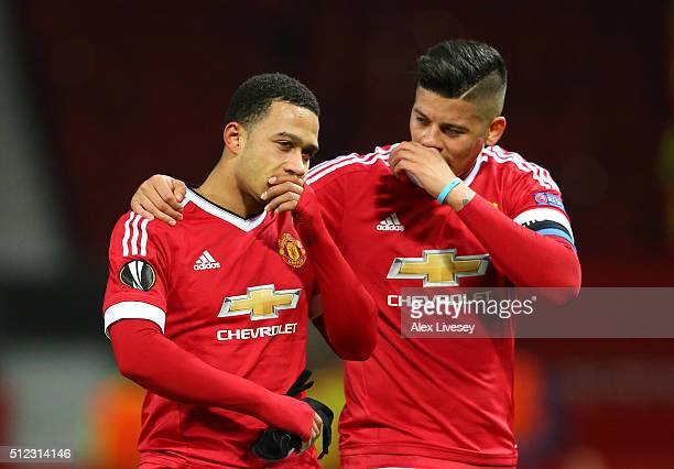 Memphis Depay and Marcos Roja of Manchester United celebrate their win in the UEFA Europa League Round of 32 second leg match between Manchester...
