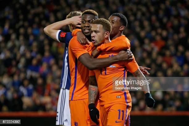 Memphis Depay of Holland celebrate 01 with Timothy Fosu Mensah of Holland during the International Friendly match between Scotland v Holland at the...