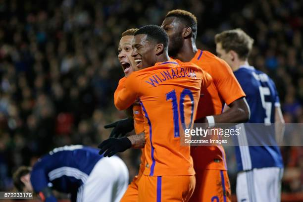 Memphis Depay of Holland celebrate 01 with Timothy Fosu Mensah of Holland Georginio Wijnaldum of Holland during the International Friendly match...