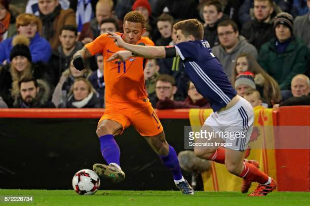 Memphis Depay of Holland James Forrest of Scotland during the International Friendly match between Scotland v Holland at the Pittodrie Stadium on...