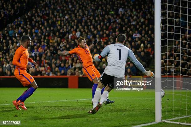 Memphis Depay of Holland scores the first goal to make it 01 during the International Friendly match between Scotland v Holland at the Pittodrie...