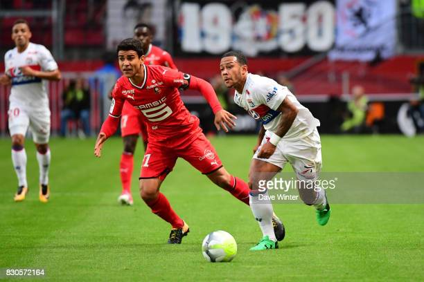 Memphis Depay of Lyon and Benjamin Andre of Rennes during the Ligue 1 match between Stade Rennais and Olympique Lyonnais at Roazhon Park on August 11...