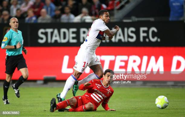 Memphis Depay of Lyon and Benjamin Andre of Stade Rennais during the French Ligue 1 match between Stade Rennais and Olympique Lyonnais at Roazhon...