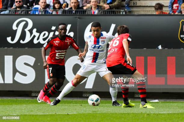 Memphis Depay of Lyon and Firmin Mubele of Rennes during the French Ligue 1 match between Rennes and Lyon at Roazhon Park on April 2 2017 in Rennes...