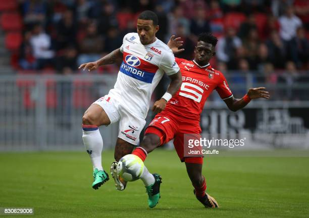 Memphis Depay of Lyon and Hamari Traore of Stade Rennais during the French Ligue 1 match between Stade Rennais and Olympique Lyonnais at Roazhon Park...