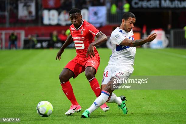 Memphis Depay of Lyon and Ismaila Sarr of Rennes during the Ligue 1 match between Stade Rennais and Olympique Lyonnais at Roazhon Park on August 11...