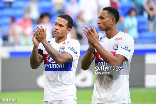 Memphis Depay of Lyon and Kenny Tete of Lyon after the Ligue 1 match between Olympique Lyonnais and FC Girondins de Bordeaux at Groupama Stadium on...