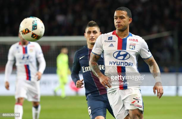 Memphis Depay of Lyon and Marco Verratti of PSG in action during the French Ligue 1 match between Paris SaintGermain and Olympique Lyonnais at Parc...