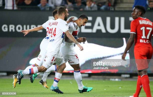 Memphis Depay of Lyon celebrates his goal during the French Ligue 1 match between Stade Rennais and Olympique Lyonnais at Roazhon Park on August 11...