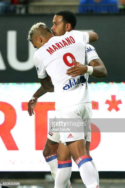 Memphis Depay of Lyon celebrates his goal with Mariano Diaz during the French Ligue 1 match between Stade Rennais and Olympique Lyonnais at Roazhon...
