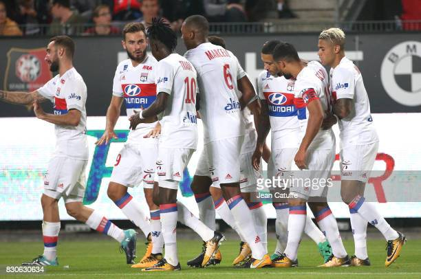 Memphis Depay of Lyon celebrates his goal with teammates during the French Ligue 1 match between Stade Rennais and Olympique Lyonnais at Roazhon Park...