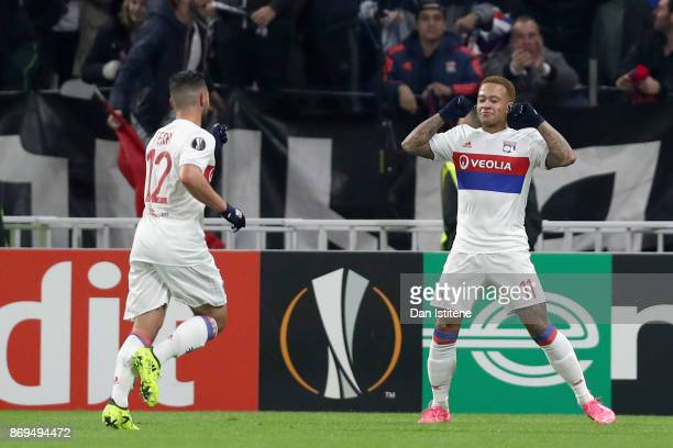 Memphis Depay of Lyon celebrates scoring his sides third goal with Jordan Ferri of Lyon during the UEFA Europa League group E match between Olympique...