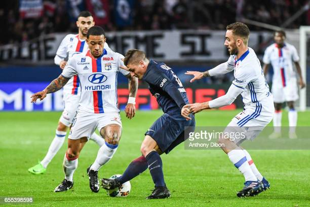 Memphis Depay of Lyon Marco Verratti of PSG and Sergi Darder of Lyon during the French Ligue 1 match between Paris Saint Germain and Lyon at Parc des...