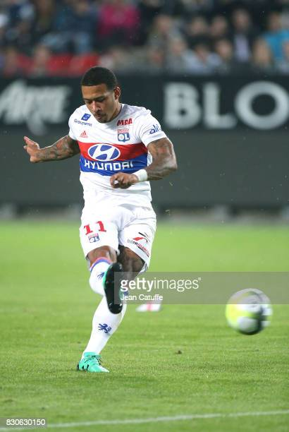 Memphis Depay of Lyon scores the first goal for Lyon during the French Ligue 1 match between Stade Rennais and Olympique Lyonnais at Roazhon Park on...