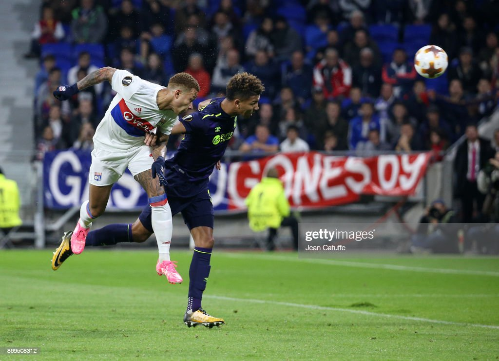 Memphis Depay of Lyon scores the third goal in front of Mason Holgate of Everton during the UEFA Europa League group E match between Olympique Lyonnais (OL) and Everton FC at Groupama Stadium on November 2, 2017 in Lyon, France.