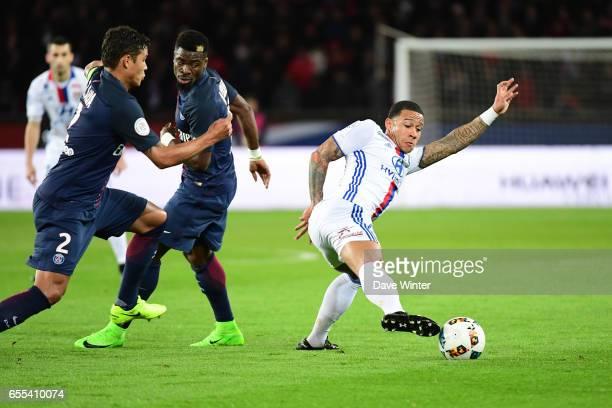 Memphis Depay of Lyon Serge Aurier and Thiago Silva of PSG during the French Ligue 1 match between Paris Saint Germain and Lyon at Parc des Princes...