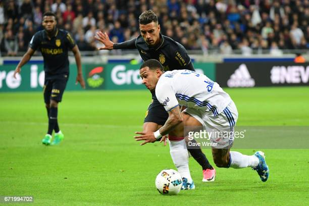 Memphis Depay of Lyon takes on Nabil Dirar of Monaco during the Ligue 1 match between Olympique Lyonnais and AS Monaco at Stade des Lumieres on April...