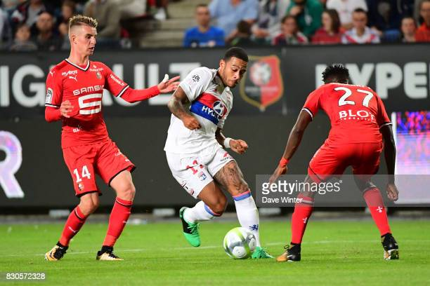 Memphis Depay of Lyon takes on the Rennes defence during the Ligue 1 match between Stade Rennais and Olympique Lyonnais at Roazhon Park on August 11...