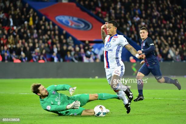 Memphis Depay of Lyon tumbles after dribbling around goalkeeper Kevin Trapp of PSG but the referee does not award a penalty during the French Ligue 1...