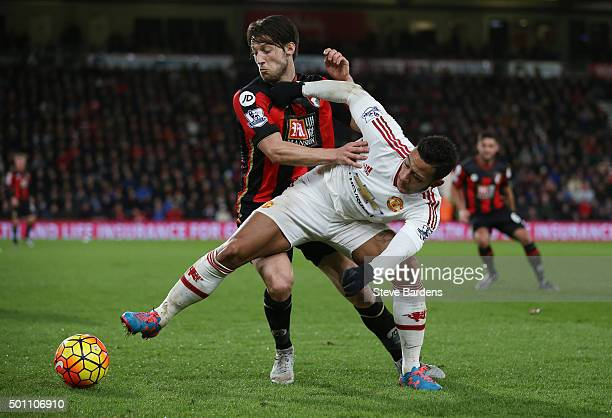Memphis Depay of Manchester United and Harry Arter of Bournemouth compete for the ball during the Barclays Premier League match between AFC...