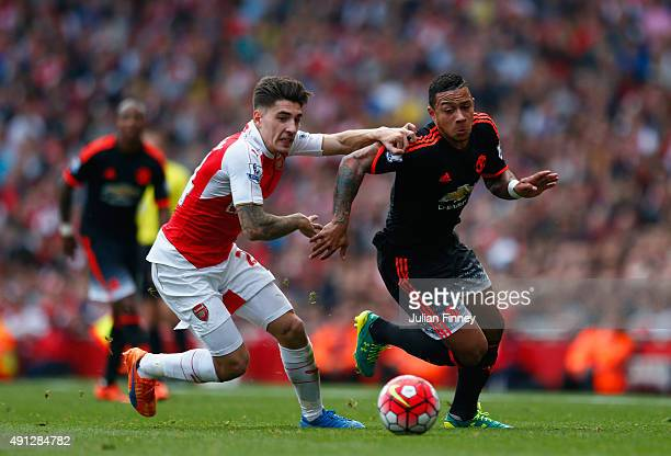 Memphis Depay of Manchester United and Hector Bellerin of Arsenal battle for the ball during the Barclays Premier League match between Arsenal and...