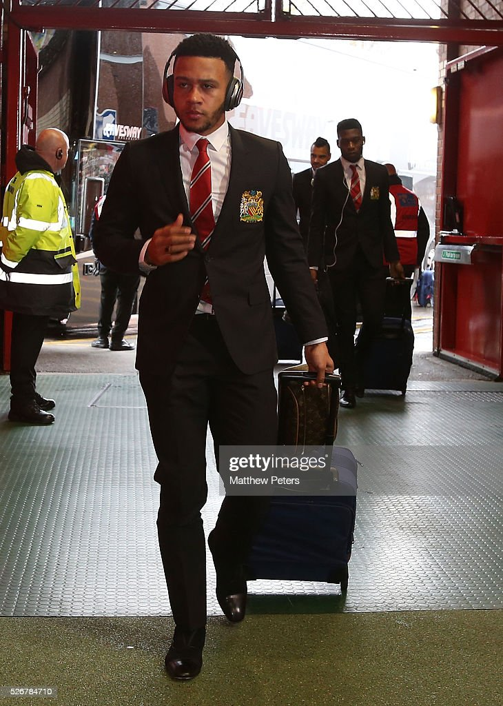 Memphis Depay of Manchester United arrives at Old Trafford ahead of the Barclays Premier League match between Manchester United and Leicester City at Old Trafford on May 1, 2016 in Manchester, England.
