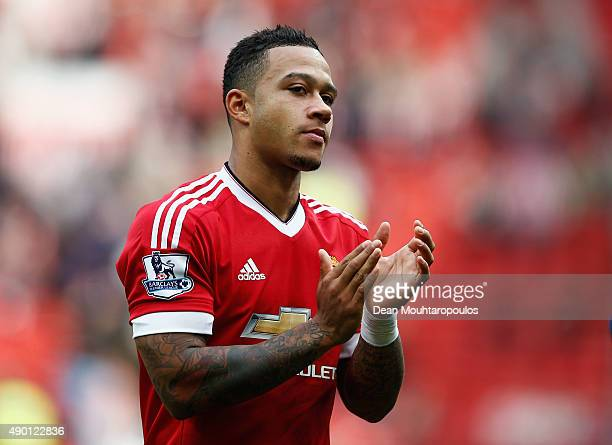 Memphis Depay of Manchester United celebrates his team's 30 win in the Barclays Premier League match between Manchester United and Sunderland at Old...