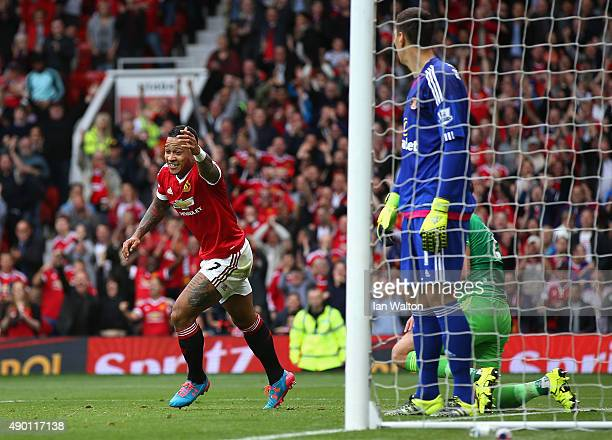 Memphis Depay of Manchester United celebrates scoring his team's first goal during the Barclays Premier League match between Manchester United and...